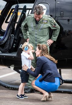 Prince George is comforted by Catherine Duchess of Cambridge as he rubs his eyes after sitting in a ''Squirrel'' helicopter similar to the one that...