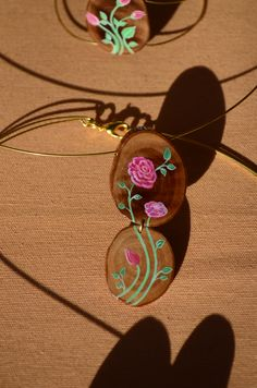 Art to wear. Olive wood,brass wire, acrylic paint