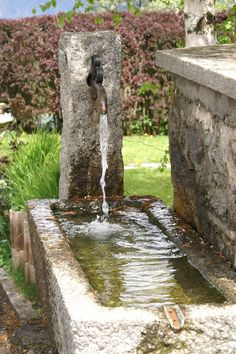 Stone water trough makes a natural water feature.