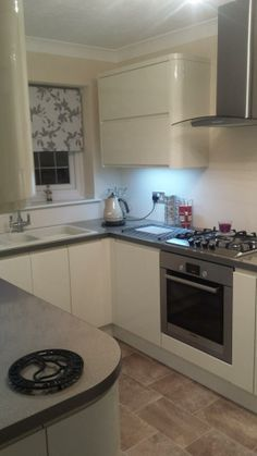 Wren Living: Handleless Cream Gloss Kitchen - brightens up the room perfectly!