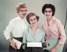 Members of the secretarial pool, late 1950s. Service with a smile and a snazzy pair of cat-eye glasses.
