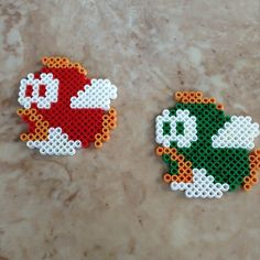 Red and green Cheep Cheep Mario fishes -- $3.25 for one, $6.50 for both Buy them here! https://www.etsy.com/listing/182105500/perler-bead-cheep-cheep-sprites