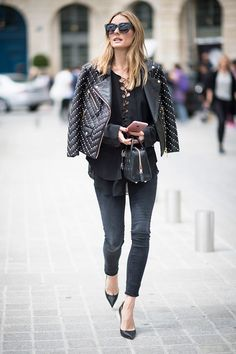 This is such a chic look—darker skinnies paired with sleek heels, a lace-up top, and a studded moto jacket.