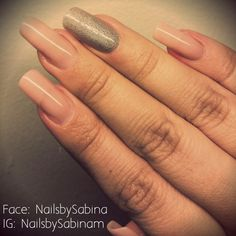 Nude acrylic nails with one accent nail in holographic glitter.