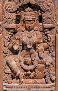 "Wooden Statue of Hindu Goddess Lakshmi -   Goddess of wealth and prosperity, both material and spiritual. The word ''Lakshmi'' is derived from the Sanskrit word Laksme, meaning ""goal."" Lakshmi, therefore, represents the goal of life, which includes worldly as well as spiritual prosperity. In Hindu mythology, Goddess Lakshmi, also called Shri, is the divine spouse of Lord Vishnu and provides Him with wealth for the maintenance and preservation of the creation."
