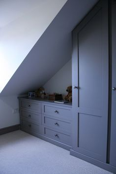 Our fitted furniture is constructed to fit angled ceilings. We design and build . Our fitted furniture is constructed to fit angled ceilings. We design and build the right fitted furniture for your loft conversion. Attic Bedroom Designs, Bedroom Closet Design, Attic Rooms, Attic Spaces, Attic Bedroom Ideas Angled Ceilings, Angled Bedroom, Sloped Ceiling Bedroom, Slanted Ceiling Closet, Attic 24