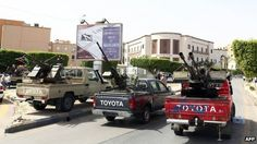 Toyota pick-up trucks mounted with anti-aircraft guns outside the Libyan foreign ministry (April 28 2013)