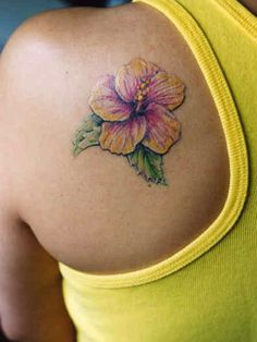 Flower Tattoo # 99 - Finest example of hibiscus flower tattoo artwork we've seen anywhere. Gorgeous babe with gorgeous pink top and amazingly gorgeous colorful hibiscus tattoo. Hawaiian Flower Tattoos, Hibiscus Flower Tattoos, Plumeria Tattoo, Dahlia Tattoo, Tattoo Flowers, Hawaiian Flowers, Hibiscus Flowers, Cute Tattoos, Beautiful Tattoos