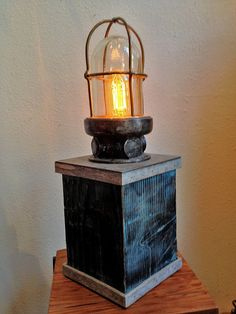 Salvaged Nautical Lamp on Reclaimed Wood. by HeSaidYes on Etsy, $250.00