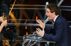 "Actor Eddie Redmayne reacts as he takes the stage to accept the Oscar for best actor for his role in ""The Theory of Everything"" during the 87th Academy Awards in Hollywood, California February 22, 2015. REUTERS/Mike Blake"