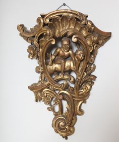 For Sale on - An opposing pair of giltwood wall brackets, each elaborately carved with C-scrolls. acanthus leaves and flowers surrounding center of Satyr astride beast. Wall Brackets, Acanthus, Modern Wall, Antique Furniture, Consoles, Lion Sculpture, Clock, Carving, Wall Decorations