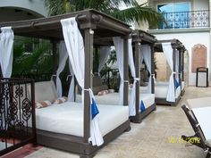 Cabana beds by the pool for small cat naps! #CCLuxe
