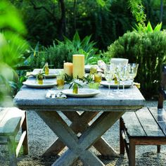 "Tuscan dining: The table    A cast-concrete table is the focal point of the outdoor dining area. ""It used to belong to a friend, and I lusted after it for years before I bought it from her,"" designer Hendershot says."