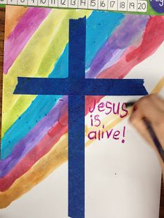 Easter Cross with painter's tape and water colors.