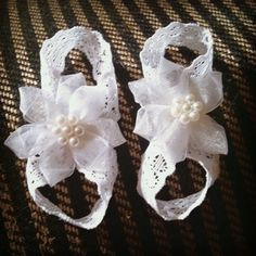 Diy barefoot newborn sandals Soooo simple! 9 inches of elastic lace (or ribbon) for each shoe formed into a figure 8 and secured with hot glue. Flower or whatever embellishment you like hot glued on top! Can't wait for baby Ariana to get here!