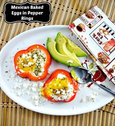 Colorful rings of red pepper make the perfect edible container for baked eggs. Served with crumbles of queso fresco and slices of creamy avocado these Mexican eggs make an impressive morning meal.