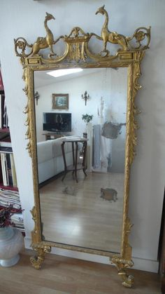 Beautiful mirror, #Italy. Decor of Indian heads and griffins. Beautiful #original #gilding. #18th century. For sale on Proantic by