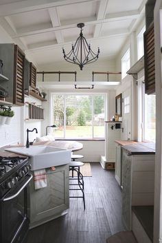 """The kitchen features reclaimed walnut and oak countertops, a full size (30"""") four burner gas range, and a 27"""" farmhouse style sink. An apartment size refrigerator is also included."""