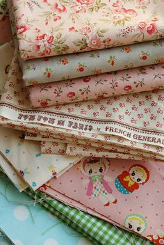 Delicious cottage style fabrics - I especially like the top pink one