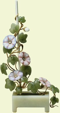 Fabergé convolvulus (morning glory) study, c.1900. The flowers are of enamelled gold centred with rose diamonds, while the leaves are of white nephrite. The plant sits in a bowenite trough. Bought by Vita Sackville-West (the doyenne of twentieth-century English garden writers) from Fabergé's London branch, 30 March 1908 (£35); later presented by the royal family to Queen Mary on her birthday, 26 May 1949