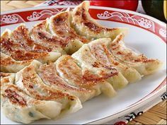 Chinese dumplings made with unleavened dough, fry/steam combo cooking method.