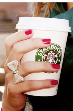 red nails + bow ring. Had a similar look this morning complete with my starbucks : ) .