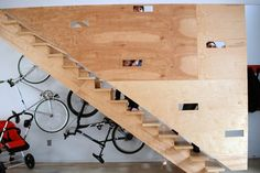 bike rack for apartment staircase bike bicycle wall rack light color wood stairs wood pattern wheels of Bike Rack for Apartment Ideas for More Effective Storage