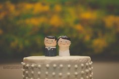 Use What You Have!  Cake-toppers made out of the champagne corks from the engagement party!