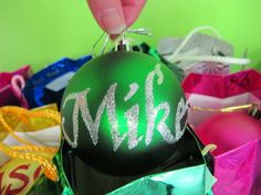 I have been writing names on baubles with glitter and glue.  They look great!  Come to the Gordonton Country Market on Sat 8 Dec 2012 and get your name on a bauble.