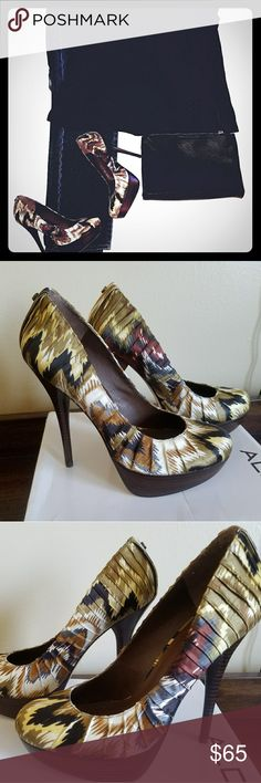 Aldo Jaylona platform pumps Stylish multi color platform pumps fit for a girls night out! Can wear with skinny jeans and a blouse or a cocktail dress.  Tried on never worn.  Refer to pictures. Size 9, but fits like an 8.  🚫 trades Aldo Shoes Platforms