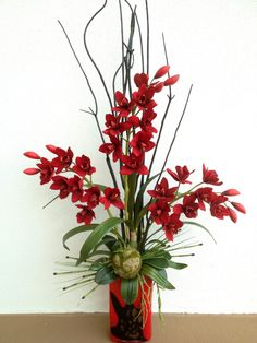 Red velvet orchid with black bamboo #arrangement. Designed by Arcadia Floral & Home Decor