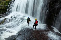 Canyoning crossing the river below Sgwd Isaf Clun-gwyn on Afon Mellte in South Wales, UK Wales Uk, South Wales, Brecon Beacons, Adventure Activities, Outdoor Activities, Niagara Falls, Britain, Waterfall, Places