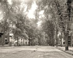 Awesome photo taken in 1908.  It just looks like such a safe, cozy, pleasant neighborhood.  Like the good old days in small towns. *sigh*