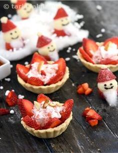 Strawberry tart is a ravishing and luscious tea-time delicacy of dainty pastry tartlets filled with slices of fresh strawberries, honey and whipped cream, and garnished with almonds. When strawberries are not in season, you can use fresh mangoes to make mango tarts instead.