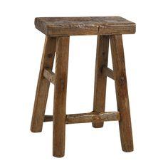 Worn wooden stool
