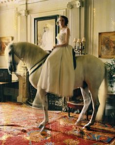 tim walker-- I just realized I have access to a horse... Now if only I had a palace to ride him through... But something with a full skirt on a horse, I think that's good...
