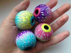 Colorful hollow beads by Domintu, polymer clay.