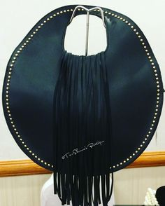Step out in #STYLE withthis #black#faux #leather oval shaped #handbag with fringe embellishment and studded accents. Shoulder strap included. | Shop this product here: spree.to/bk24 | Shop all of our products at http://spreesy.com/theyovettagroup    | Pinterest selling powered by Spreesy.com