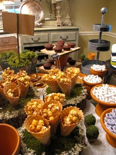 LoVe, LOvE, LOVE the idea of serving popcorn in waffle cones at a party! Fill with fun flavors from Tastebudspopcorn.com .