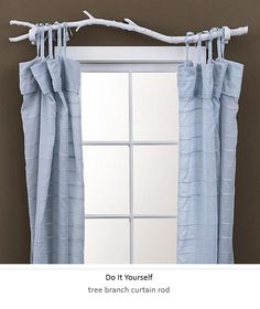 unique, like how light shines through curtains DIY - tree branch curtain rod - www.bhg.com