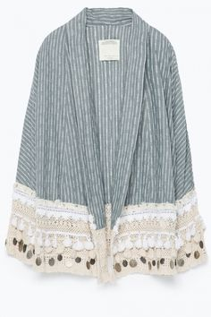 Nail two trends at the same time with this gorgeous folk-style kimono from Zara... http://lookm.ag/B7lma3