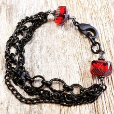 "Need to find a use for those leftover chain bits? This bracelet only uses about 5"" of each chain style; combine it with Czech glass and a chunky clasp, and voilà, a 7.5"" bracelet! #chainbracelets #czechglass #goth #gothjewelry #chain #handmadejewelry #belladonnabeads #czechbeads"
