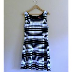 """(167) Black and White Striped Dress - Size L Flattering black and white striped dress. Has belt loops and looks great belted but no belt is included with purchase. Zipper closure in back. Easy to wear and can be dressed up or down. Bust: 38"""", waist: 34"""", hip: free,  length: 38"""", label: Merona, size: Large, materials: polyester, rayon, spandex. #Merona #striped #stripes #blackandwhite #mididress #midi #retro Merona Dresses Midi"""