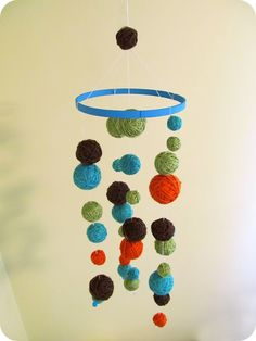 paint foam balls and wrap in yarn cute for baby.