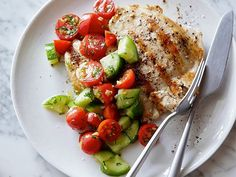 Ditch starchy sides in favor of this energizing Grilled Chicken with Tomato-Cucumber Salad.