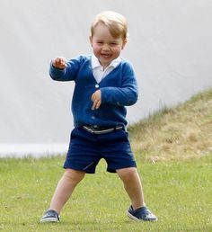 Prince George at his father Prince William's polo game at the Beaufort Polo Club in Tetbury, Gloucestershire June 14, 2015.