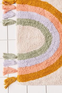 Shop Rainbow Fringe Bath Mat at Urban Outfitters today. We carry all the latest styles, colours and brands for you to choose from right here. Bathroom Rugs, Bath Rugs, Bathroom Cleaning, Plywood Furniture, 1950 Diner, Eames, Urban Outfitters, Floral Shower Curtains, Rainbow Room