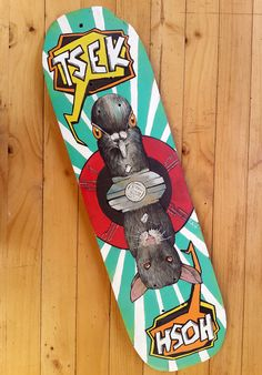 """This reclaimed skate deck is hand-painted and produced for the 2016Colours Of You SACreative Festival which recently took place in Port Elizabeth. Several artists were selected to transform a skatedeck into an artwork and then have them exhibited at the event.  30% of the sale of this artwork will be donated toUmzobo Wam, which """"supports South African children in sharing stories of township life through art and photography.""""You can find out more about themHERE.  This piece is titled…"""