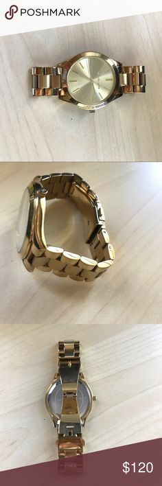 Gold Michael Kors watch Matte and glossy gold-plated face, signs of wear but no major damage. Batteries need to be replaced. A few links removed, can measure upon request. All stainless steel Michael Kors Accessories Watches