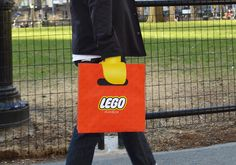 as the user reaches inside to grip a pair of handles, their wrists are covered by two, yellow LEGO hands.